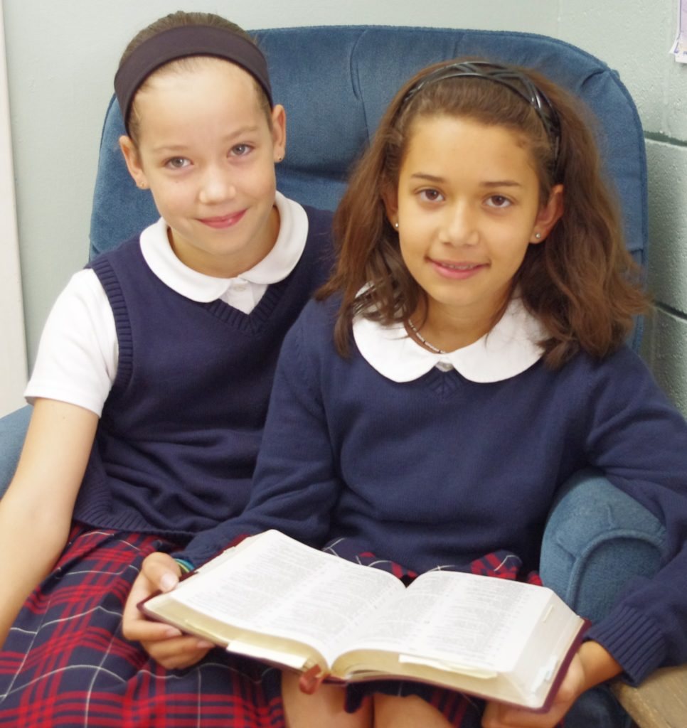 Two girls with Bible